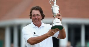 Phil Mickelson lifts the Claret Jug in 2013, at Muirfiled.